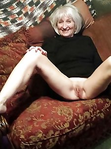 Stunning older lass fingering herself