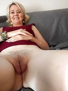 Experienced lasses spreading their pussy