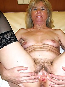 Glamour mature woman spreading her lips