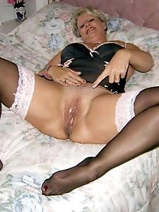 Erotic old girl getting undressed on camera